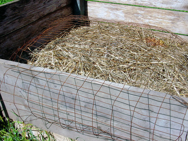 wire covering humanure compost bin